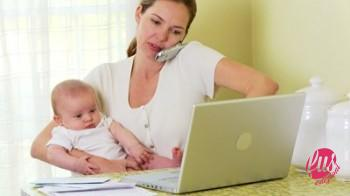 stock-footage-mother-working-on-laptop-with-baby