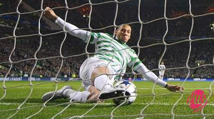 Celtic's Kevin Wilson clears a shot off the line from Juventus' Alessandro Matri (unseen) during their Champions League soccer match at Celtic Park stadium in Glasgow, Scotland February 12, 2013. REUTERS/David Moir (BRITAIN - Tags: SPORT SOCCER)