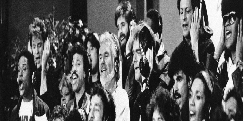 "Some of a group of 45 music artists calling themselves ""USA For Africa"" recording ""We Are The World"" in Los Angeles, Calif. Jan. 30, 1985. Bottom row, from left; Cyndi Lauper, Bruce Springsteen, James Ingram, Smokey Robinson, Ray Charles, Sheila E., June Pointer, Randy Jackson. Middle row, from left; Al Jarreau, Dionne Warwick, Lionel Richie, Kenny Rogers, Huey Lewis, Bob Dylan, John Oates, Ruth Pointer. Top row, from left; Daryl Hall, Steve Perry, Kenny Loggins, Jeffrey Osborne, Lindsay Buckingham, and Anita Pointer. (AP Photo)"